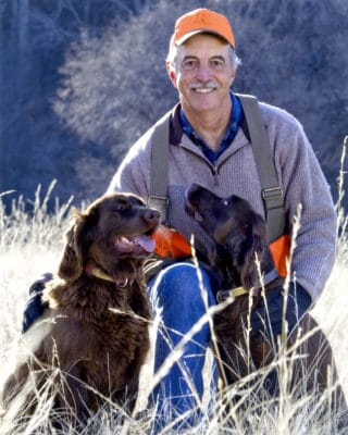 Mitch Rohlf's, author, posing with his two dogs